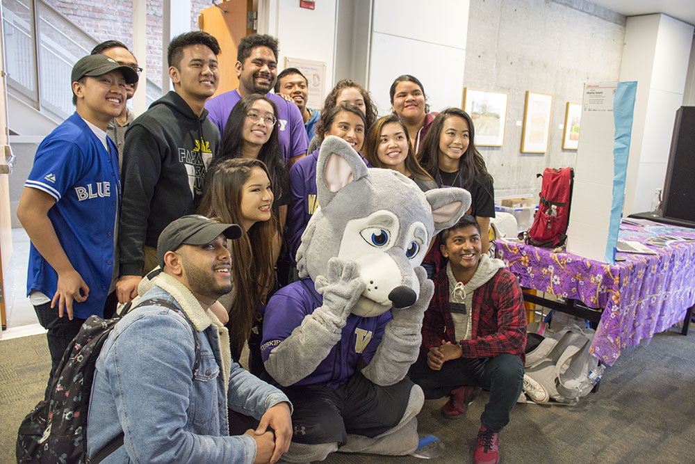 Photo of students surrounding Hendrix the Husky mascot