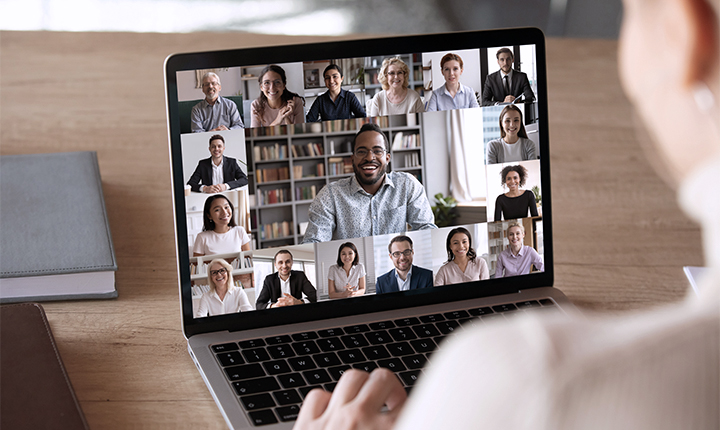 laptop with Zoom video faces