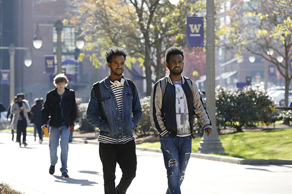 Photo of two students outdoors walking