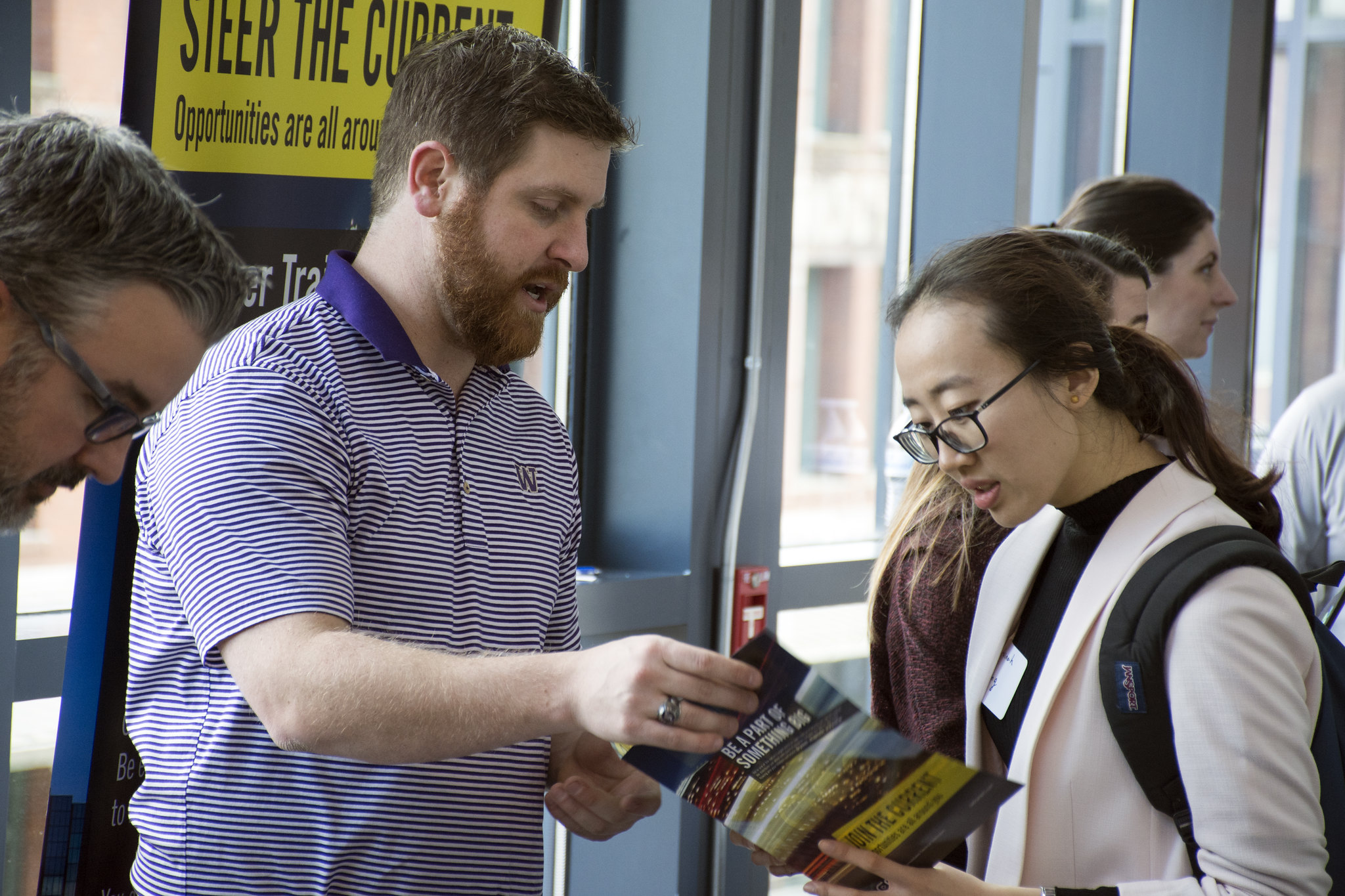 Milgard Success Center inaugural career fair, features an employer talking with a Milgard student