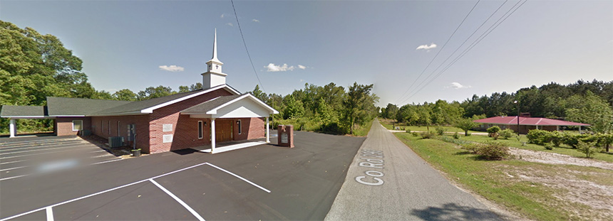 Google Street View image of East Baptist Church (left) and Lange's childhood home near Pachuta, Miss.