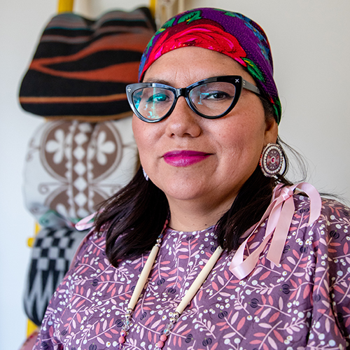 Headshot of UW Tacoma Ed.D. Director Robin Minthorn. Minthorn is wearing glasses, a multi-colored head wrap and a floral print dress.