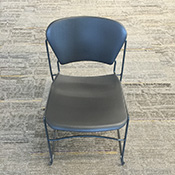 Black metal chair with black plastic seat and seatback