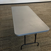 Rectangular table with black metal legs and gray plastic top