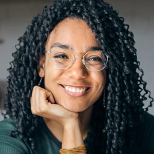 Young woman smiling (headshot)