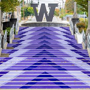 Large purple arrow graphics on Grand Staircase point up to the Steel W at UW Tacoma.