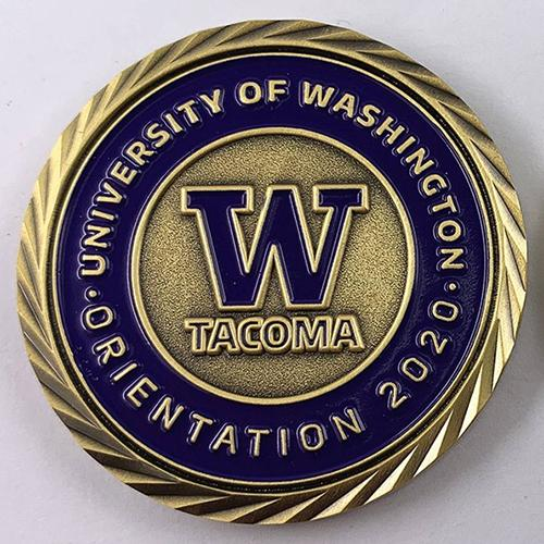 """Photo of a challenge coin that says """"University of Washington Orientation 2020 and W Tacoma"""""""