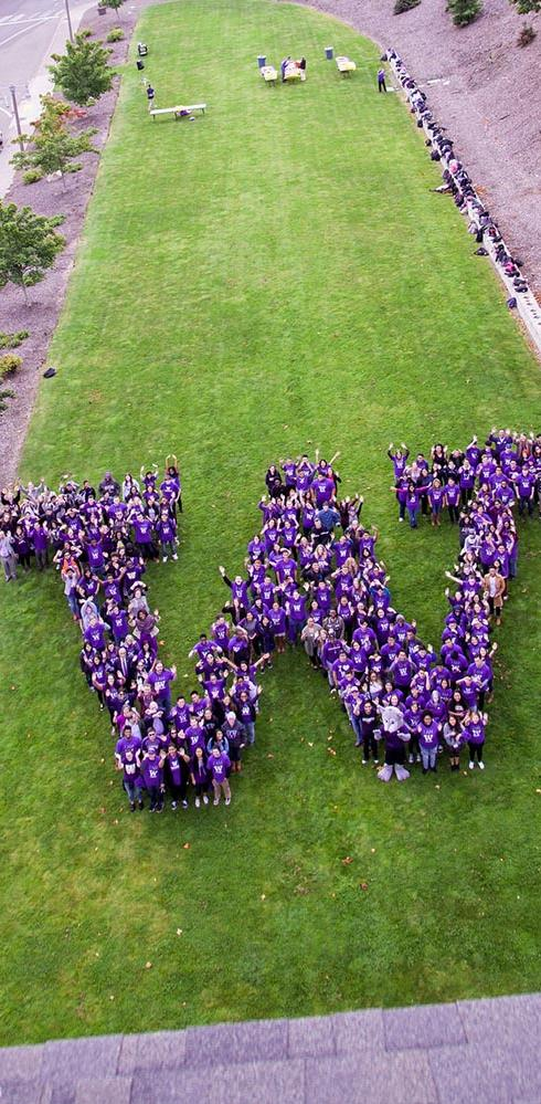 Photo of people wearing purple in the shape of the W logo