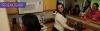 "Photo of students in a kitchen in a student apartment with the text ""friendship"" on it"